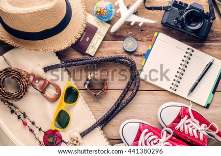 Travel accessories on wooden floor ready for travel - stock photo