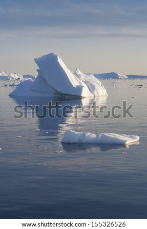 Travel along the Western coast of Greenland. Icebergs and glaciers. Deep pure waters. - stock photo