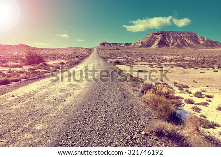 Travel and adventures through remote desert landscape.Desert landscape and road.Sunset scenic  - stock photo