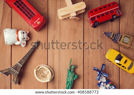 Travel and tourism concept with souvenirs from around the world. View from above - stock photo