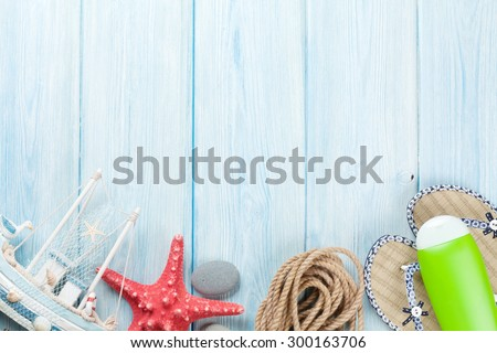 Travel and vacation background with items over wooden table. Top view with copy space - stock photo