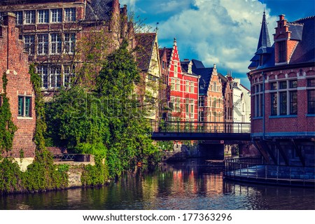 Travel Belgium medieval european city town background with canal. Ghent, Belgium. Retro vintage hipster style cross processed. - stock photo