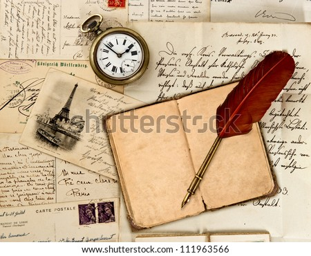 travel book diary, old letters, post cards and feather quill. nostalgic vintage background - stock photo