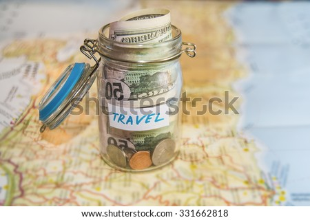 Travel budget vacation money savings glass stock photo download now travel budget vacation money savings in a glass jar on world map collecting money gumiabroncs Choice Image