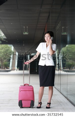 travel business woman call on mobile phone