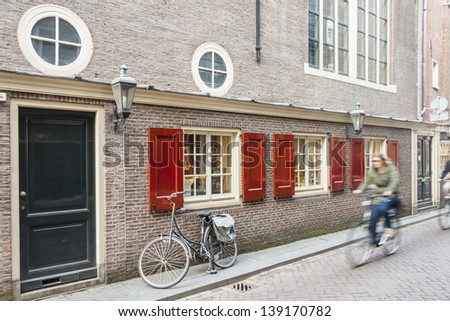 Travel by bicycles on old town of Amsterdam - Netherlands, Europe. - stock photo