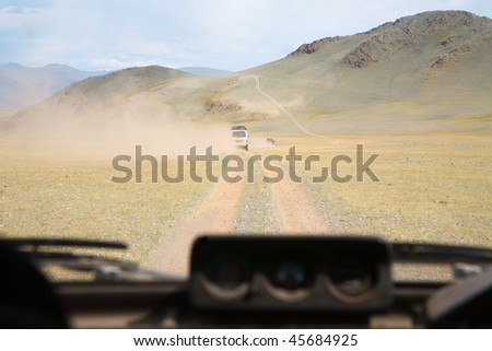 Travel by car on the Asian steppe - stock photo