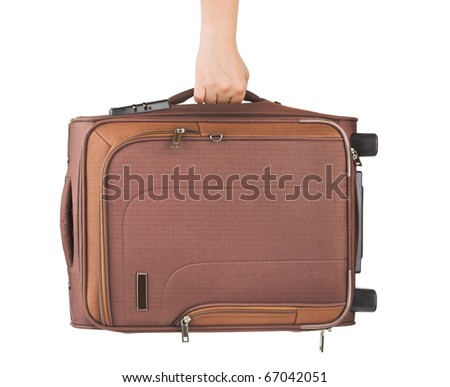 Travel case and hand isolated on white background - stock photo