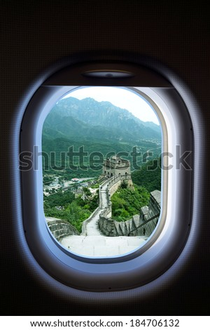 travel China, view of window aircraft with Great Wall of China - stock photo