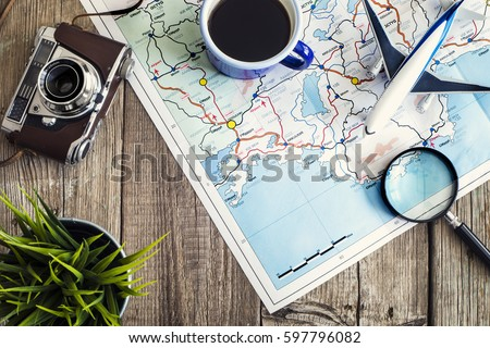 Travel concept on wooden table