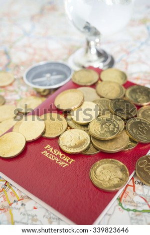 Travel concept; passport, coins, compass and crystal globe - stock photo