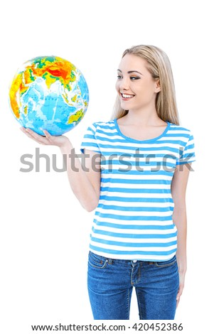 Travel concept. Portrait of stylish beautiful young woman isolated on white background. Woman smiling and holding globe
