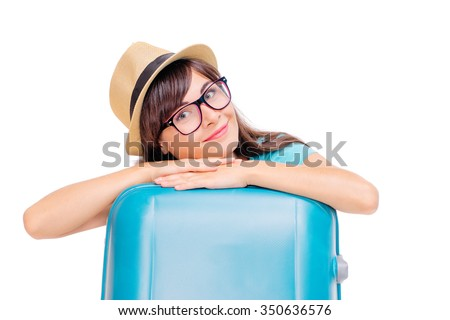 Travel concept. Studio portrait of pretty young woman in hat with suitcase. Isolated on white. - stock photo