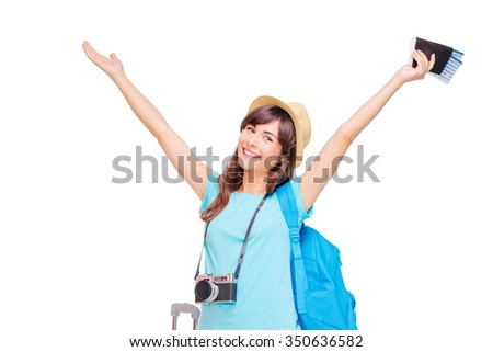 Travel concept. Studio portrait of pretty young woman with hands up holding passport with tickets. Isolated on white. - stock photo