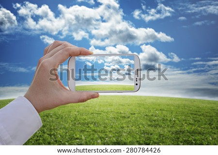 Travel concept - Taking a picture with a smart phone - stock photo