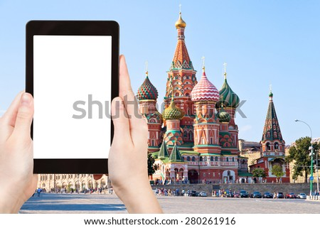travel concept - tourist photograph Pokrovskiy cathedral, Red Square with Vasilevsky descent in Moscow, Russia on tablet pc with cut out screen with blank place for advertising logo - stock photo