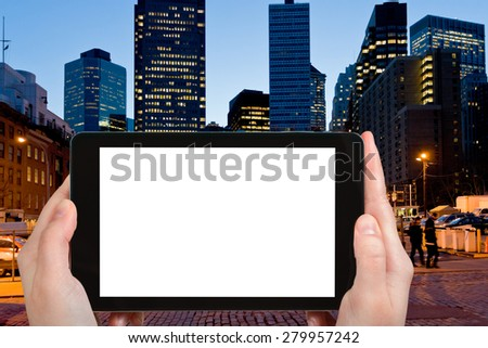 travel concept - tourist photograph South Street Seaport district in New York City on tablet pc with cut out screen with blank place for advertising logo - stock photo