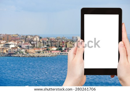 travel concept - tourist photograph Villa San Giovanni of city Reggio di Calabria from Strait of Messina, Italy in summer day on tablet pc with cut out screen with blank place for advertising logo - stock photo