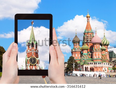travel concept - tourist photographs picture of Vasilevsky Descent on Red Square in Moscow Kremlin on tablet pc - stock photo