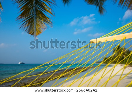 Travel concept with a hammock in a tropical beach - stock photo