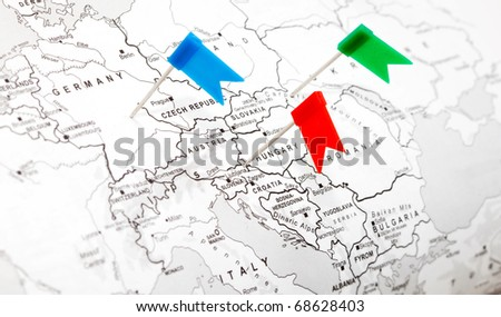 Travel concept with flag pushpins and map - stock photo