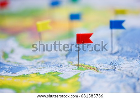 Travel concept with flag pushpins and world map