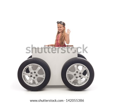 Travel concept with little girl and wheeled box - on white background - stock photo
