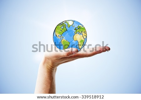Travel concept with man hand and round earth