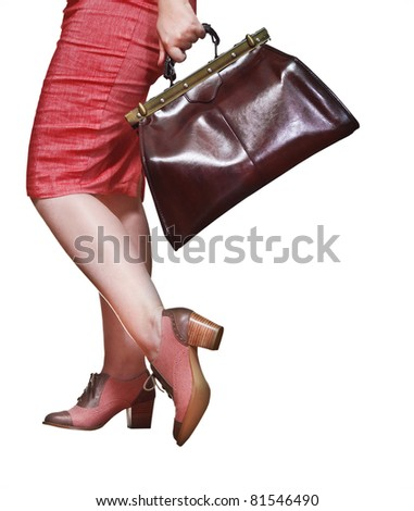 Travel concept. Woman with baggage. Isolated on white - stock photo