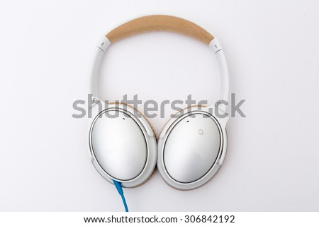 travel cord headphones isolated on white background