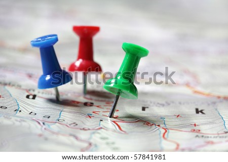 Travel destination marked with pushpins - stock photo