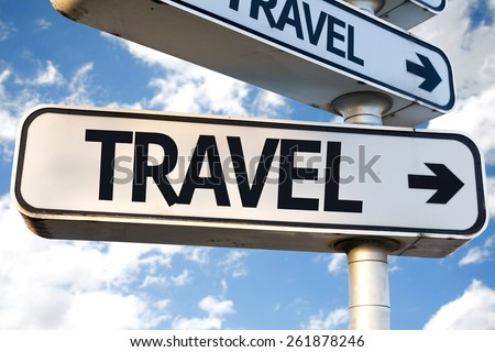 Travel direction sign on sky background - stock photo