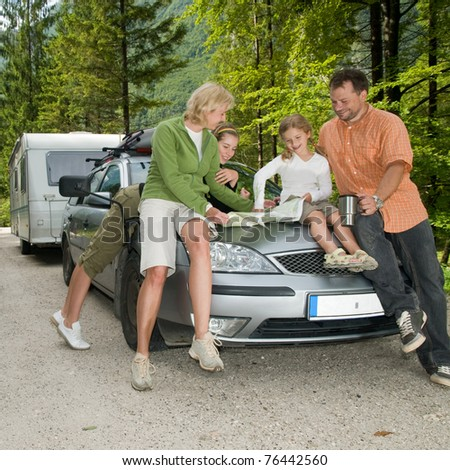 Travel - family with camping car on the road - stock photo
