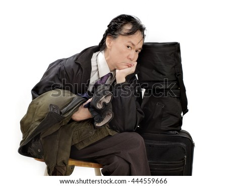Travel flight delay .  Business professional ethnic asian male frustrated disappointed looking man waiting . White background isolated