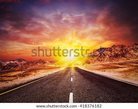 Travel forward concept background - vintage retro effect filtered hipster style image of road in Himalayas with mountains and dramatic clouds on sunset. Ladakh, Jammu and Kashmir, India - stock photo