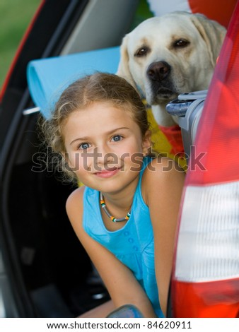 Travel - Girl with dog ready for the travel for summer vacation - stock photo
