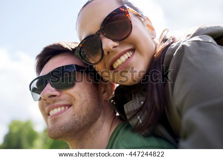 travel, hiking, backpacking, tourism and people concept - happy couple in sunglasses having fun outdoors