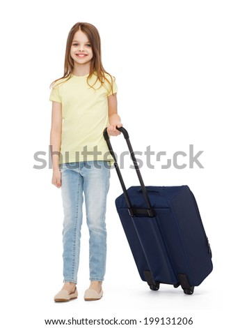 travel, holiday, vacation, childhood and transportation concept - smiling little girl with suitcase - stock photo