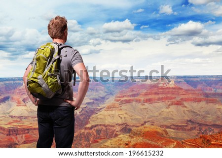 Travel in Grand Canyon , man Hiker with backpack enjoying view, USA, caucasian - stock photo
