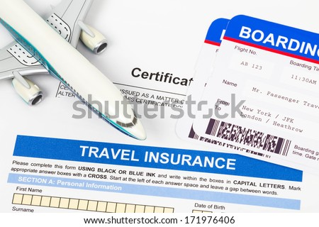 Travel insurance application form with plane model and boarding pass - stock photo