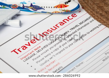 Travel Insurance Claim application form and hat with eyeglass on brown envelope, business insurance and risk concept; document and plane is mock-up - stock photo