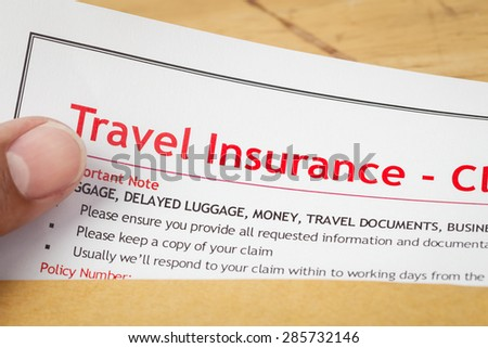 Travel Insurance Claim application form and human hand on brown envelope, business insurance and risk concept; document is mock-up
