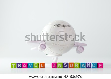 Travel insurance word in front of 3D aeroplane puzzle