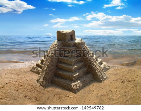 Travel Mexico. Sandcastle copy of mexican pyramid on the beach.  - stock photo