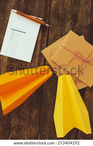 Travel. Paper airplanes on the table - stock photo
