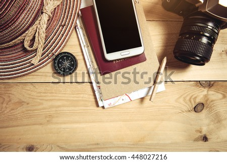 Travel plan, trip vacation, tourism mockup - Outfit of traveler on wooden background - stock photo