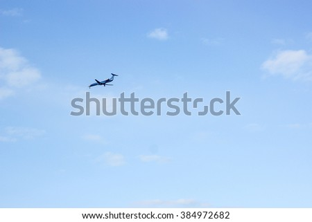 Travel plane in the summer blue sky