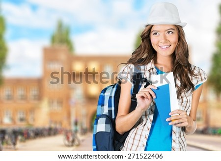 Travel. Portrait of happy tourist woman holding passport on holiday on white background - stock photo