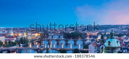 Travel Prague concept background - elevated view of bridges over Vltava river from Letn���¡ Park. Prague, Czech Republic in twilight - stock photo