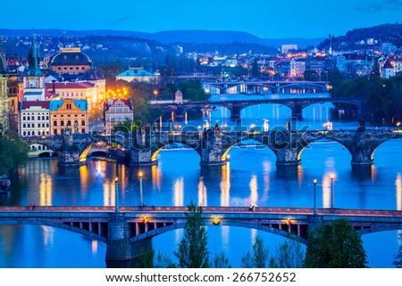 Travel Prague concept background - elevated view of bridges over Vltava river from Letn�¡ Park. Prague, Czech Republic in twilight - stock photo